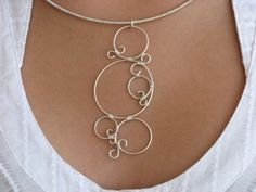 in Harmonee...ecologically responsible art jewelry    Simply elegant and so comfortable to wear!    This set includes the pendant, neckwire and