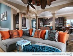 15 Stunning Living Room Designs with Brown, Blue and Orange Accents- not big on the pattern on the pillows but the over all color scheme is awesome! by dolores