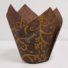 A more elegant liner for your delicious muffins. Made with grease proof paper, these brown tulip shape cups have gold swirl design on brown paper. Use with a standard 2 bottom diameter muffin pan, the tulip shape provides a unique way to present muffins. Increase sales at your bakery with these fashionable cupcake/muffin cups. Depth measurements taken from the lowest point of where two adjoining petals meet varies from approximately 2-1/8 to 2-1/2. The height measurement for the peak is ...