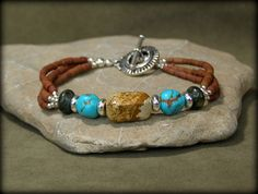 Turquoise and silver beaded bracelet.