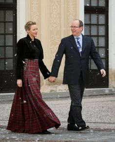 Prince Albert&Princess Charlene Attend The Christmas Gifts Distribution in Monaco, love her floor length kilted skirt in Stewart tartan.