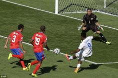 Bend it like Sturridge: The England forward attempts to curl a shot into the inside of the net