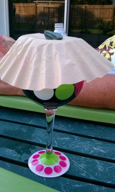 How to keep flies out of your wine glass when enjoying the outdoors -- coffee filter + a small rock