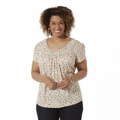 This women's plus scoop neck top by Basic Editions has the comfortable feel of a T-shirt with a flowing, flattering fit. Designed with braided trim at the neckline and gathered short sleeves, this leaf-print top takes a style cue from vintage peasant tops. A jersey knit construction adds cottony softness.