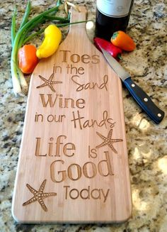 Cutting board with beach quote. Toes in the Sand....: http://www.completely-coastal.com/2015/12/home-decor-gift-ideas-coastal-beach-style.html