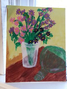 Asters with antique ships bottle
