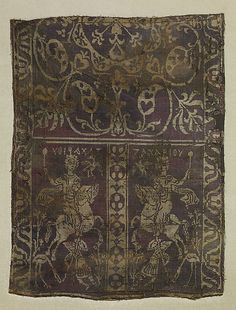 """Fragment of a Band with Noble Equestrian and Soldier, Inscribed """"Zacharaiou"""" in Greek  Date: 7th-9th century (?) Geography: Made in, Egypt or Syria (?) Medium: Weft-faced compound twill ( samit ) in reddish purple and beige silk Dimensions: 14 9/16 x 11 7/16 in. (37 x 29 cm)"""