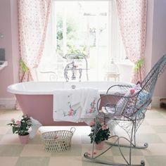 Bath & Body:  A romantic pink bath with clawfoot bathtub.