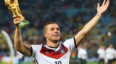 2014 FIFA World Cup™ - Photos - FIFA.com  Lukas Podolski of Germany celebrates with the World Cup trophy