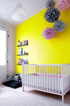 what a fun wall. minimal furnishings but a pop of color:)