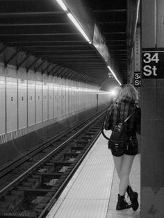 Girl on 34th st platform by Ray Wu.