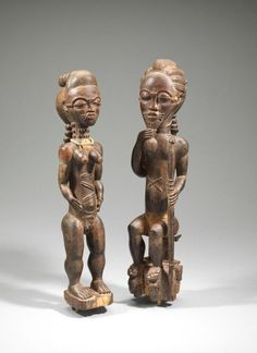 Nature Spirits (Asie Usu) Circa. 19th Century Country: Côte d'Ivoire   Cultural peoples: Baule Peoples   Materials: Wood, beads and pigment paint. Measurement: Female; h. 45.70 cm., Male; h. 48.30 cm. Housed: Fowler Museum at UCLA Gifted: George G. Frelinghuysen Museum Purchase: X67.2033ab © 2017 Fowler Museum