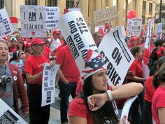 Chicago Teachers Union strikers march though the Chicago financial district at LaSalle and Jackson
