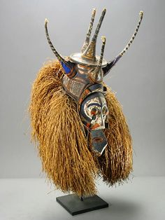Africa | Circumcision Mask from the Yaka people of southwestern Congo/Angola | 20th century | Wood, polychrome paint and raffia