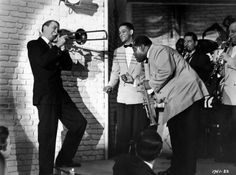 "James Stewart, Trummy Young and Louis Armstrong in ""The Glenn Miller Story"" (1954)"