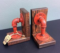 """Industrial Pipe Book Ends (pair). Constructed of ½"""" iron pipe with a DISTRESSED HYDRANT RED finish mounted on wood supports. This industrial pipe set of bookends is an excellent industrial accent for… Industrial Bookends, Industrial Pipe, Industrial House, Industrial Style, Industrial Kitchens, Plumbing Pipe Furniture, Industrial Furniture, Diy Furniture, Reclaimed Furniture"""