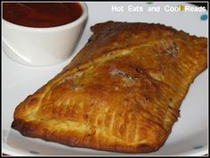 Hot Eats and Cool Reads: Crescent Roll Calzones Recipe  http://www.hoteatsandcoolreads.com/2011/11/crescent-roll-calzones.html#