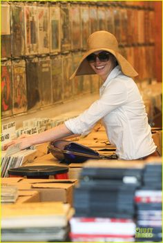 Anne Hathaway searching for vinyl records