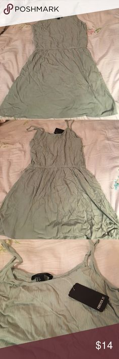Sage green spaghetti strap dress Perfect condition (never worn/washed) with tag still on! Color is a gorgeous jade green (my terrible lighting does it no justice)! Straps are thin and adjustable. Has an elastic waistband to give it some shape. Purchased from Forever 21. Price is negotiable 😊🌹 Forever 21 Dresses