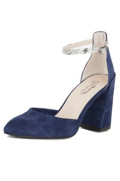 """""""Gaggle"""" by Seychelles in black or indigo suede is a perfect combo of modern and classic. The classic elements of this heel--the delicate ankle strap and pointy toe--are updated with the chunky bold heel that widens slightly as it goes down. The indigo suede version also has a faux snakeskin print ankle strap. Either color would look great with a jeans and a boyfriend blazer for date night or pair with a cocktail dress to attend a holiday party.    Heel is 3 inches.   Ankle Strap Pump by…"""
