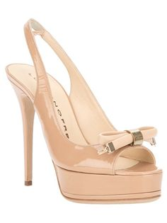 Beige leather sandals from Luis Onofre featuring a sling back ankle, a round open toe, a bow detail on front and a stiletto heel.