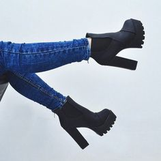 black ankle boots on a high steady thick heel