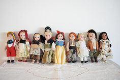 nine porcelain dolls  characters  from famous  fairy tales