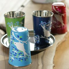 Fair trade hand painted cups are eye catching in four vibrant colors. Inspired by the colors of India and in keeping with an Indian tradition of decorating and adding color to everyday objects. These cups are great for picnics, holding flowers and pens, or brightening up a dinner party. Made from food safe stainless steel. Not dishwasher proof. Hand wash only.