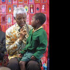 Mandela with child - Nelson Mandela Centre of Memory