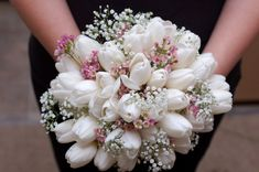 White tulip, baby's breath, and wax flower bridal bouquet with burlap and lace http://weddingflowersbyemily.blogspot.com/