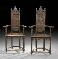Gothic Revival: Pair of Continental Gothic-Style Walnut Armchairs, 19th century, each with a shaped crest and crocket finials above a narrow paneled back wi...