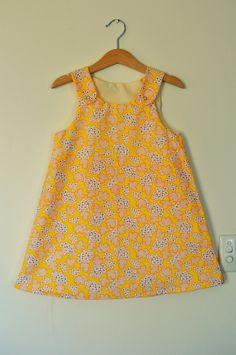 Girls yellow floral a-line classic pinafore dress age 5. $30.00, via Etsy.