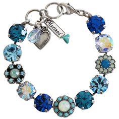 "Mariana Silver Plated Large Daisy Shapes Swarovski Bracelet, 7"" Blue Lagoon. Available at www.regencies.com"