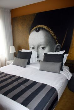 Love the power of enormous wall graphics -bedroom mural...cool but perhaps a tad creepy though....