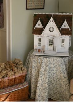 "Cynthia's made this lovely miniature house from a kit called the Orchid by Greenleaf dollhouses.     In Cynthia's words   ""In my mind, th..."