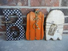 "From YouCraftMeUp...BOO wood cutouts. The ""B"" looks like one of the Hallowe'en fonts from DAFONT.com. Very cute!"