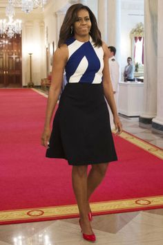 The First Lady's Best Looks: Michelle Obama sported nautical colors at the presentation for the National Medal for Museum and Library Service at the White House; wearing a navy and white Narciso Rodriguez top and skirt paired with red pumps for the event.