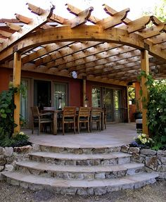 Magnificent large trellis with a half moon timber design attached to the house. If you love circular designs you're going to love this. Do note the flagstone steps leading down from the raised patio.