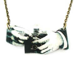 Hands Holding a Vintage Camera Shaped Acrylic Illustrated Pendant Necklace | DOTOLY