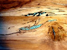 Solid wood dining room table inlayed real inlayed turquoise stone...oh if only it was affordable!