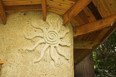 sun spiral Sculptural detail of a cob house on Salsbury drive in Vancouver. Natural or earthy things are popular motifs on cob houses. And we must have Sun/Moon motifs Cob Building, Green Building, Building A House, Sustainable Architecture, Architecture Details, Residential Architecture, Contemporary Architecture, Adobe House, Natural Homes