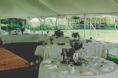 #ringsontheizings Wedding Reception: woodland, whimsical, fairy tale, summer, outdoors, happily ever after, pole tent, rustic, ranch decor, DIY Floral: Margareta Warlick
