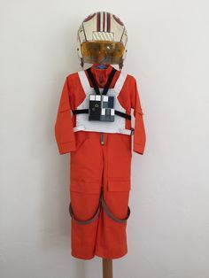 Star Wars X-Wing Fighter Luke Kids Costume   Basic ingredients: One used football helmet, McCall's Jumpsuit Pattern M5952, foam core, household electrical wire.    Detailed instructions and downloadable decals in post. Great for Halloween or cosplay.