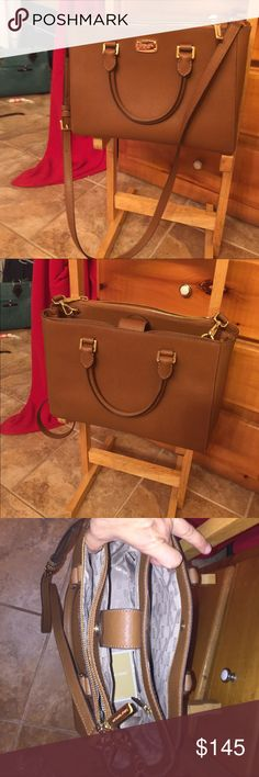 Authentic Micheal kors Sutton tote and shoulder Authentic micheal kors Beautiful brown Sutton with gold hardware it's a roomy bag has two side pockets and four small ones inside as Well as change great buy Michael Kors Bags Totes