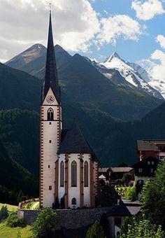 Heiligenblut church and Grossglockner peak in Austria.