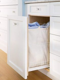 Throw dirty towels in a hamper beneath the vanity. More storage-packed baths: http://www.bhg.com/bathroom/storage/storage-solutions/ultimate-storage-packed-bathrooms/?socsrc=bhgpin072613hamper=21