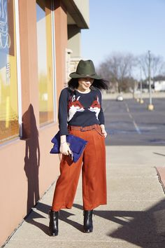 petite winter fashion street style  Uniqlo jacket + Ann Taylor fox prints sweater + Vince Camuto orange wide leg pants + DV black boots + olive wool hat + blue bag