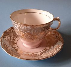 COLCLOUGH PALE PINK WITH GOLD CHINTZ TEA CUP AND SAUCER VINTAGE LONGTON ENGLAND
