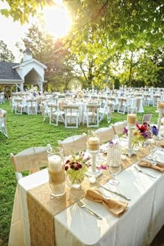 Love the rustic burlap look with flowers & candles on this table setting