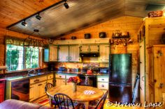 Kitchen in my barn apartment.  Love this space. Great for crafting get togethers. Green Leaves Boutique homestead.